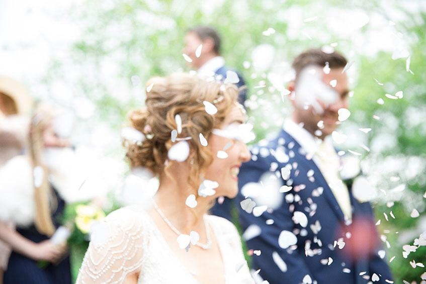 wedding confetti smiling bride