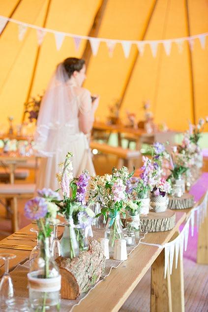 dinosaur wedding with natural wild flowers in summer