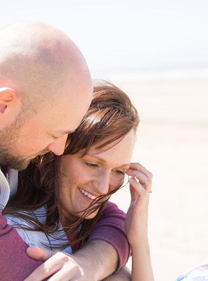 windy beach weather couple
