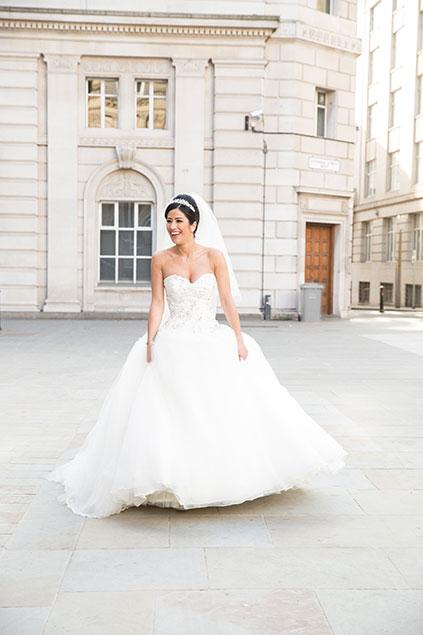 Bride walking in Liverpool dress