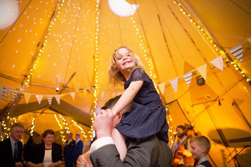 tipi wedding tent little girl smiling