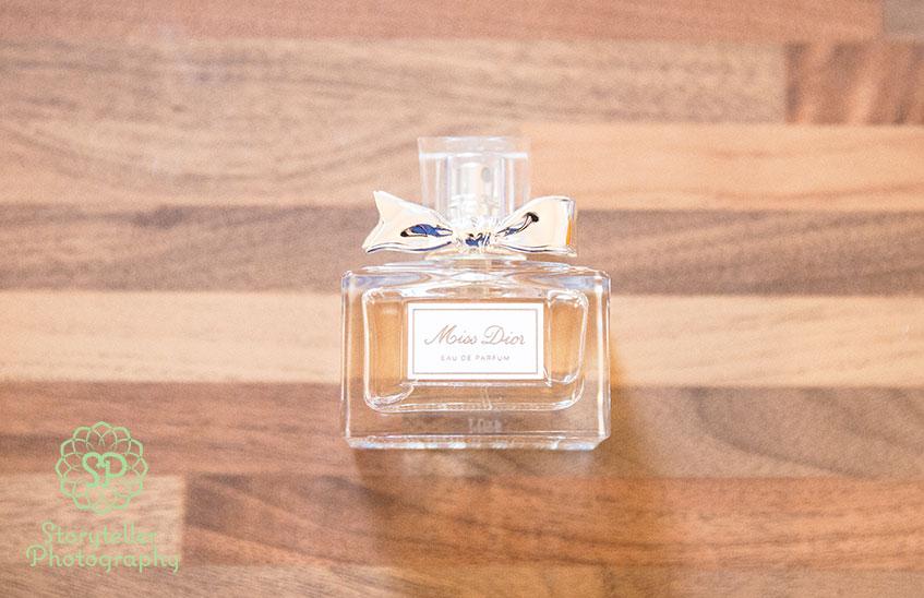 miss dior wedding perfume against wooden background