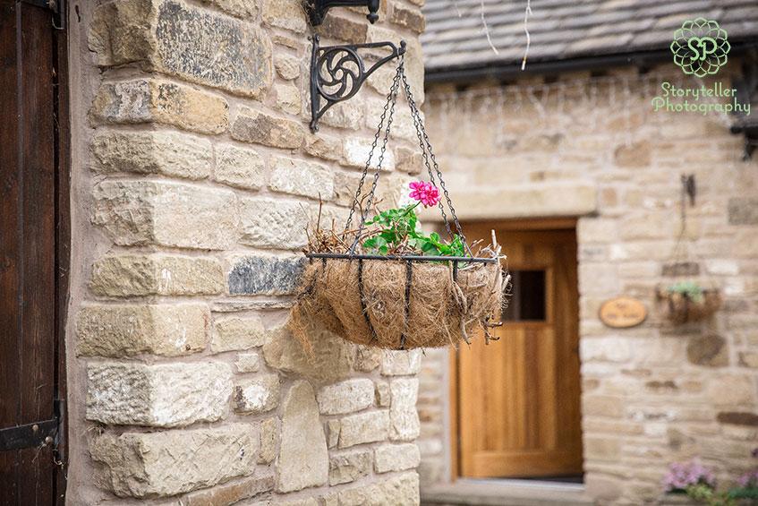pink hanging basket on farm outside cottages