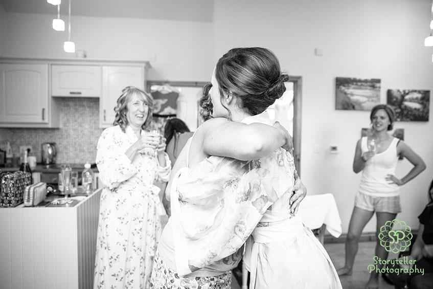 sisters emotional hug on morning of wedding day