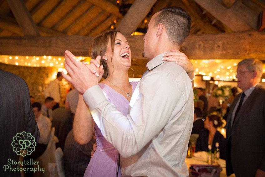 bridemaid dance with boyfriend in grey shirt